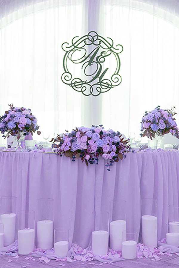 A wedding monogram at the head table can make your budget wedding look more upscale and posh.