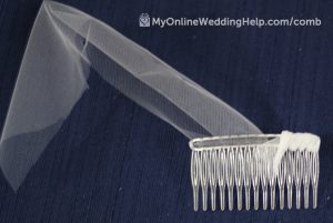 Wrapping a bridal veil comb.