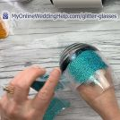 Step 2 in making your DIY fancy / wedding wine glass is to apply glitter.