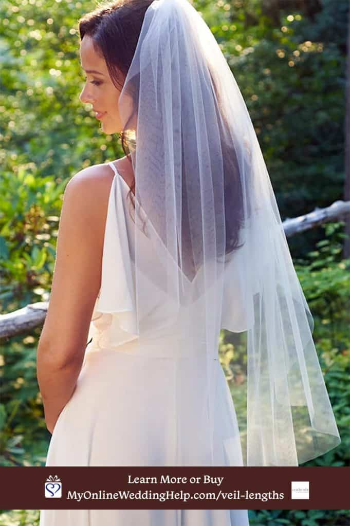 Simple cut edge wedding veil folded back to appear to be two tiers.